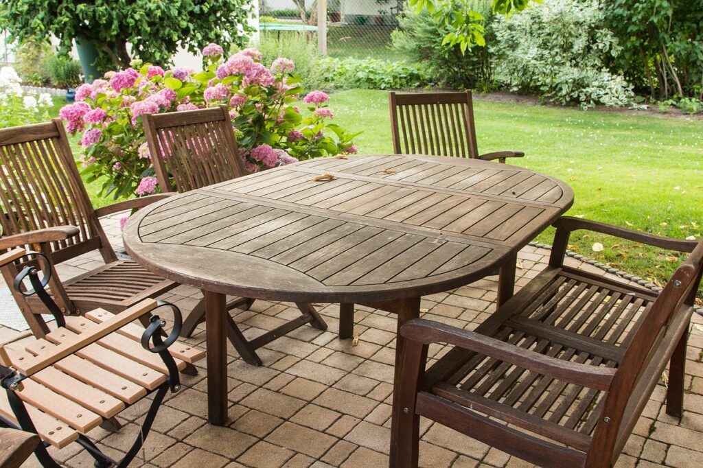 Outdoor Teak Furniture FAQs Teak Patio Furniture World - Teak patio table with leaf